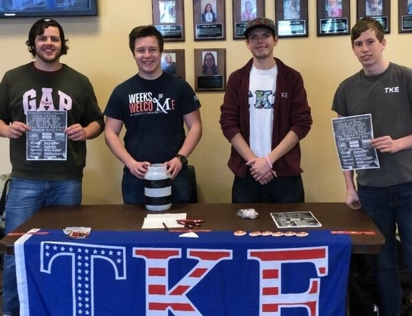 A Few Brothers Tabling For The Upcoming Event